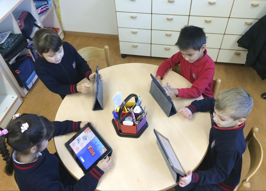 TASIS Elementary School students working with the Scratch iPad app