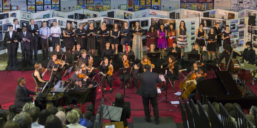 Backed by a professional chamber orchestra, the High School and Faculty Choirs perform at the 2017 Spring Arts Festival.