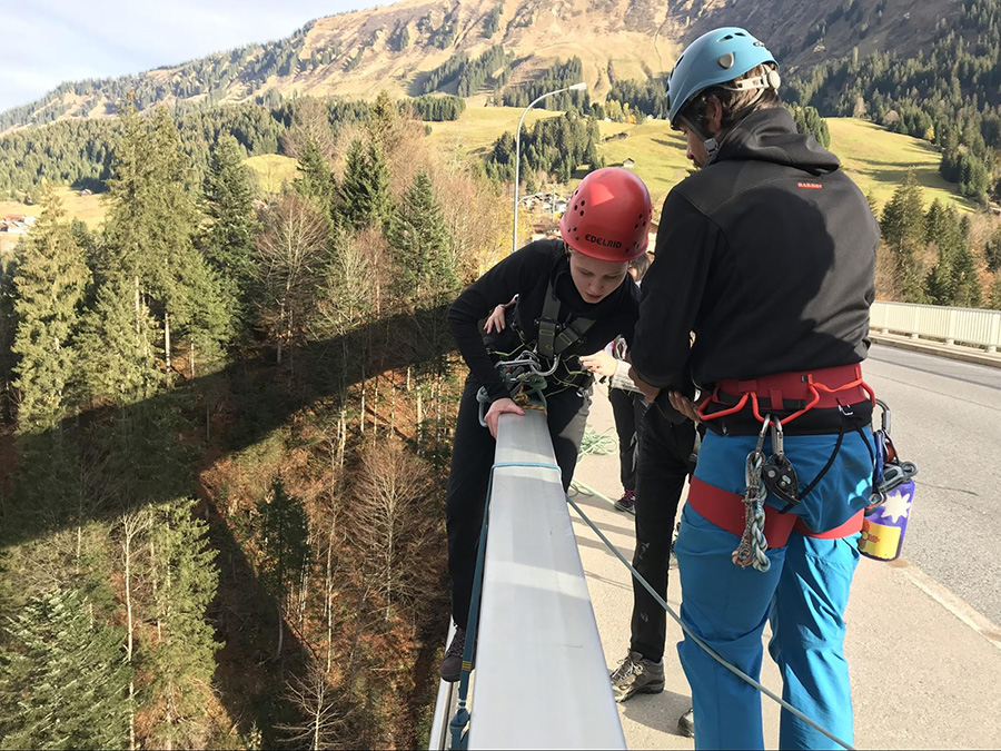 Rapelling from a bridge