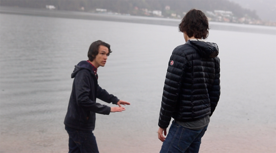 Alex directs the climactic Lake Lugano scene in Ric Tac Toe.