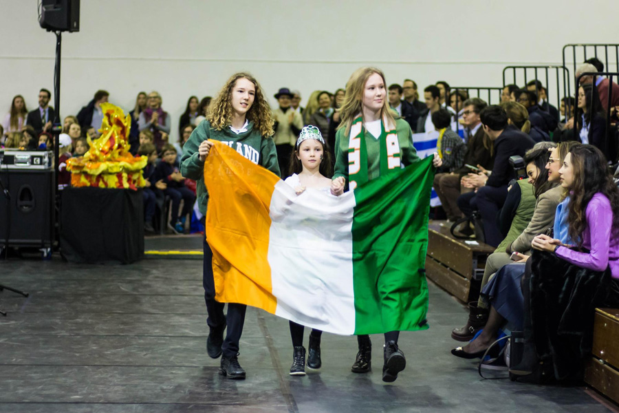 Wilson holding the flag of Ireland at International Week