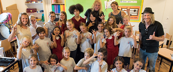 Gotthard members Leo Leoni and Nic Maeder with the TASIS Elementary School and Middle School Choirs.
